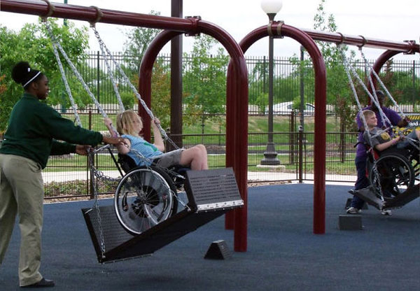 Swings for children on wheelchairs