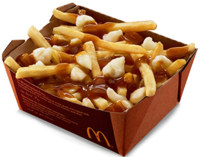 Poutine - snack with chips, gravy and cheese