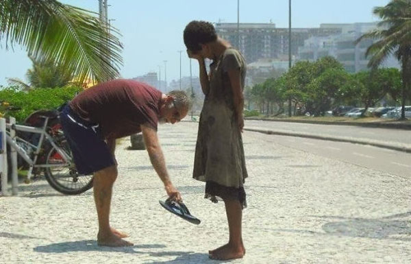 faith in humanity restored with man giving his shoes to a homeless