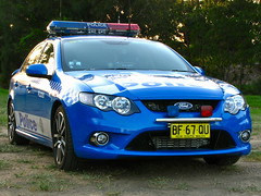 race car(0.0), world rally car(0.0), sports car(0.0), automobile(1.0), automotive exterior(1.0), vehicle(1.0), automotive design(1.0), police car(1.0), ford fg falcon(1.0), full-size car(1.0), ford motor company(1.0), bumper(1.0), ford(1.0), sedan(1.0), ford falcon (australian version)(1.0), land vehicle(1.0), luxury vehicle(1.0),