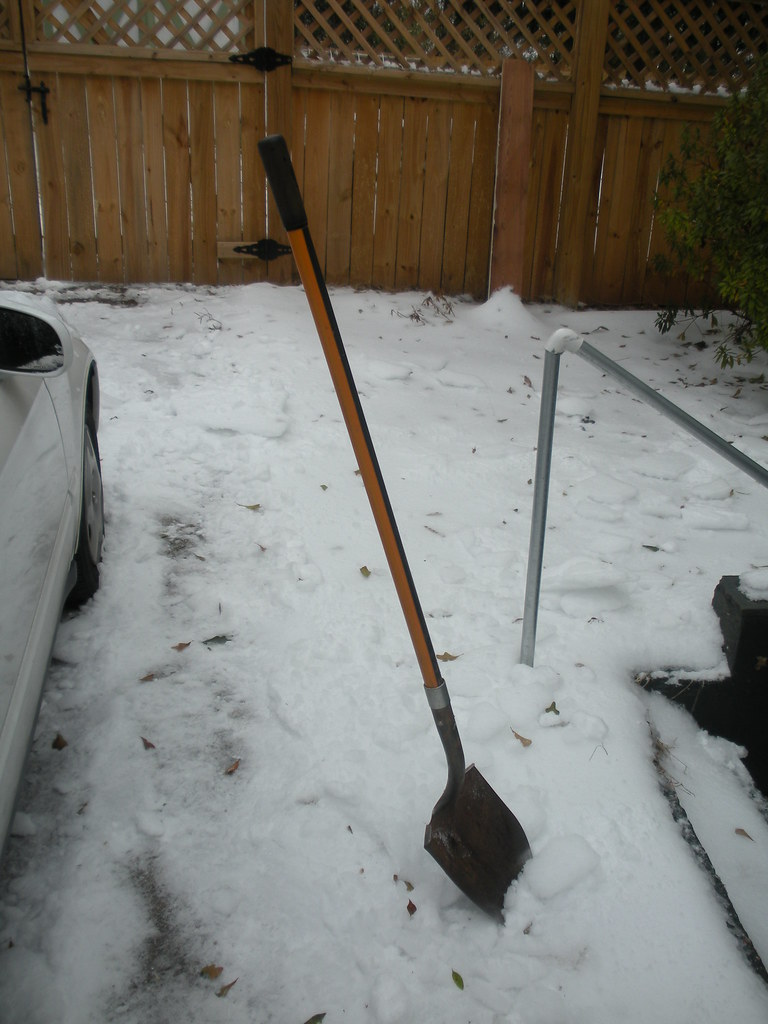 There's enough ice to hold a shovel upright.