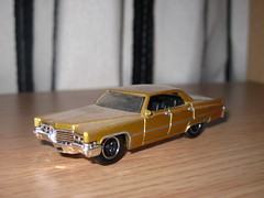 "dirt covered ""69 Cadillac DeVille"