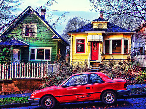 Red car , yellow house , green house