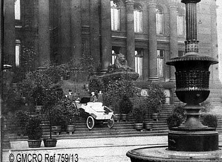 One George Cane in his car on the steps of Bolton Town Hall in the 1890s. (GB124.DPA.759/13).
