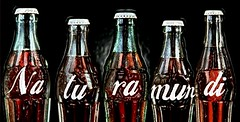 beer bottle(0.0), coca-cola(0.0), glass bottle(1.0), soft drink(1.0), carbonated soft drinks(1.0), bottle(1.0), drink(1.0), cola(1.0),