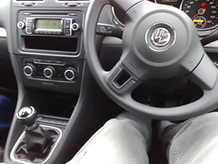automotive exterior(0.0), rim(0.0), automobile(1.0), wheel(1.0), volkswagen(1.0), vehicle(1.0), steering wheel(1.0), volkswagen polo(1.0), land vehicle(1.0),
