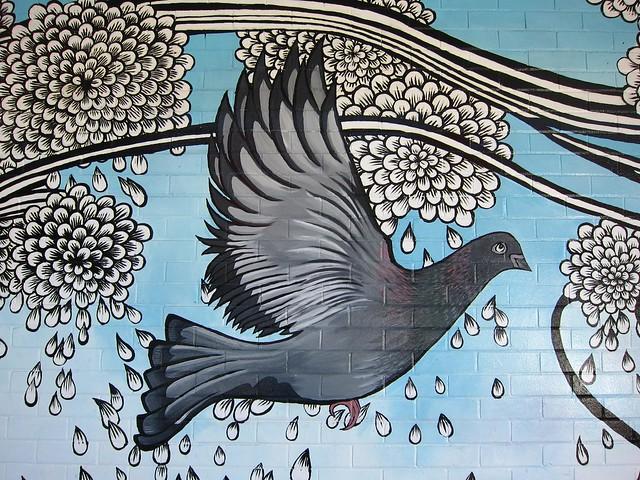 Street Art - Pigeon Flying Through Flower Petals