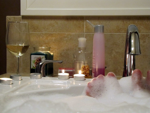 clean tub with person taking bubble bath