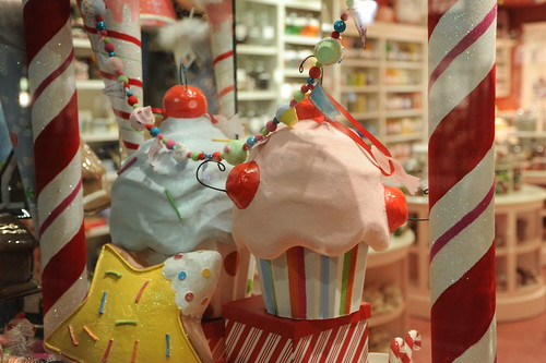 Candy canes and cupcakes in the candy store window, the Night before Christmas, Seattle, Washington, USA by Wonderlane