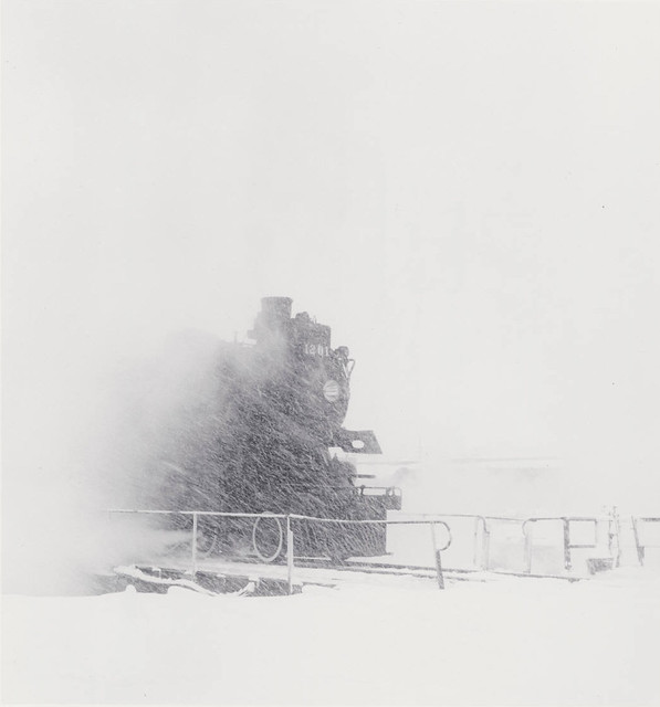 Canadian Pacific Railway locomotive number 1201 in snow storm, the Glen engine terminal, Montreal, Quebec, by David Plowden 1960