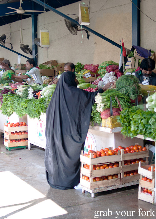 Local shopper at Al Hamriya Fruit and Vegetable Market next to Dubai Fish Market in Deira