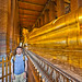 Chris in front of the reclining Buddha at Wat Pho by joestump
