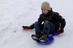 snow angel(0.0), winter sport(1.0), winter(1.0), snow(1.0), sledding(1.0), freezing(1.0), sled(1.0),