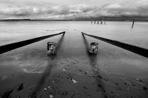 old sea bw beach water pier boat washington sand rail shore pugetsound launch piling dilapidated boatlaunch hansville pointnopoint