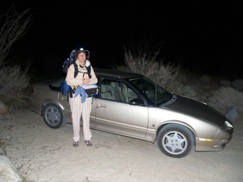 Vicki at the car, 10pm and ready to hike!