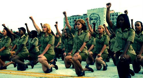 A group of Cuban women pledging to defend the revolutionary nation and state from U.S. imperialism and its allies. The revolution celebrated its 52nd anniversary on Jan. 1, 2011. by Pan-African News Wire File Photos