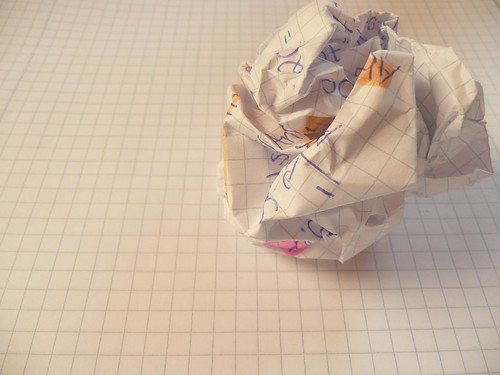 writer's block - crushed and crumpled paper on notepad
