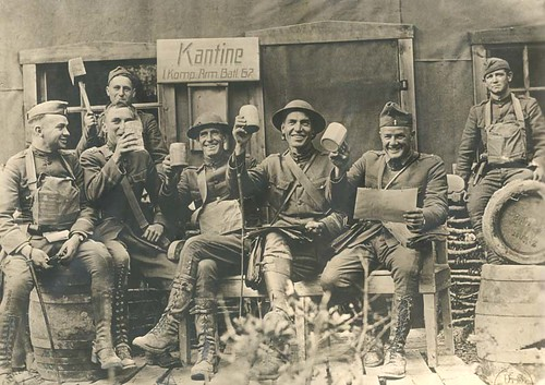 A group photo of Shadworth Oldham Beasley (1876-1918) with JL Cammell, RL Coe, AG Montgomery, DR Peacock and unidentified persons in army fatigues in front of an army cantine