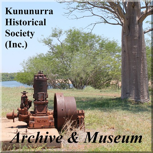 "Kununurra Historical Society Inc. - Archive & Museum (In Text) A 2010 view looking up-river from the high east bank over the Ord River with a majectic boab to the right. There is a rusted looking industrial pump engine on a concrete pad surrounded by grass. The pump engine, is a Petter's ""Atomic"" Diesel Engine  used at Carlton Reach by Kimberley Michael Durack in 1941 for the first)"