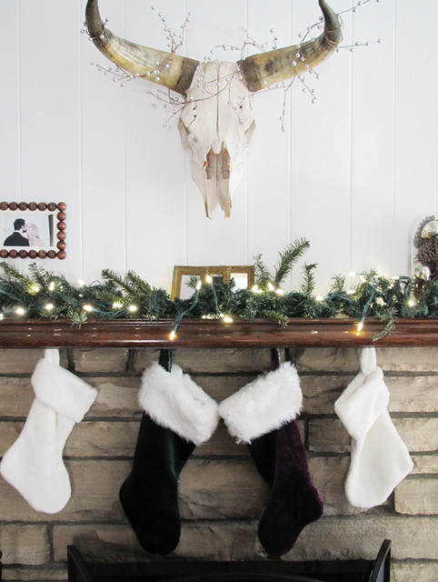 Holiday mantel christmas mantle stockings on the fireplace cow skull with holiday decor light - Superb modern christmas decor ideas ...