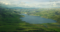mountain, reservoir, valley, plain, mountain range, loch, lake, hill, highland, tarn, fell, meadow, landscape, wilderness, aerial photography, rural area, lake district, mountainous landforms,