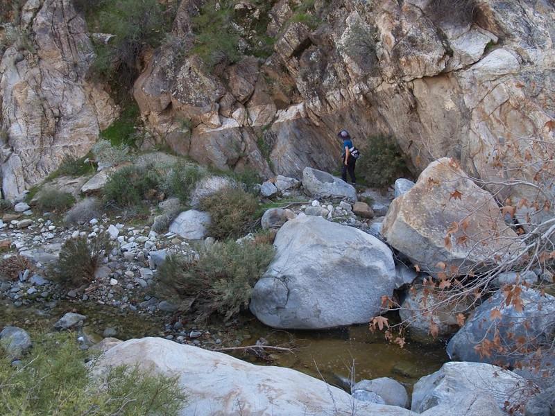 Vicki hiking downstream