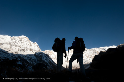 travel nepal terrain snow mountains nature silhouette sport standing sunrise trekking trek bag outdoors photography climb frozen asia looking hiking walk awesome extreme scenic dramatic conservation environmental peak bluesky rockface glacier snowcapped adventure clear explore trail journey backpack summit destination environment abc remote daytime nepalese hobbies rucksack majestic eastern range tough twopeople challenge naturalworld himalayas isolated carry admiring haul highaltitude nepali gurung appreciating glaciated movingup colorimage annapurnabasecamp annapurnasanctuary 3040years colourimage annapurna1 annapurnaone 2030years 8000mpeak annapurnaglacier
