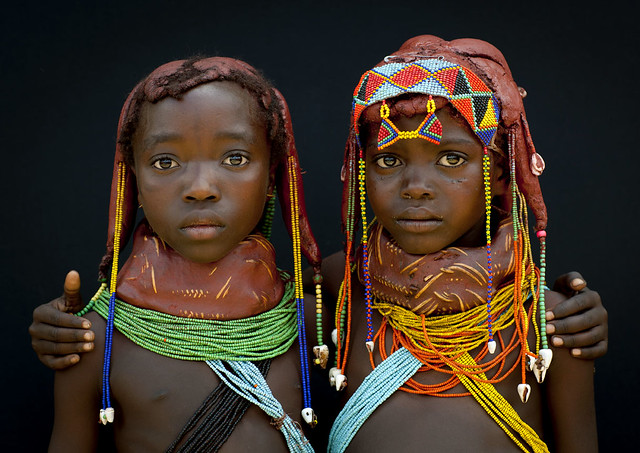 Those little girls from the Mumuhuila tribe live near Chibia, ...