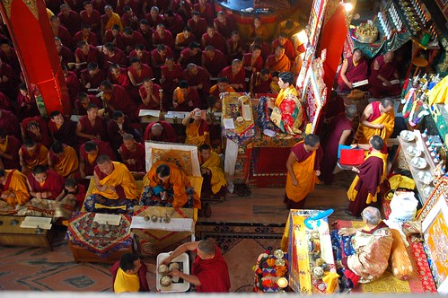 Lamas serving Long Life Rice to His Holiness Jigdal Dagchen Rinpoche, Lamdre dedication mandala offering completed, with his grandson Avikrita Rinpoche leading the assembly of monks, nuns, lay people, Tharlam Monastery, Boudha, Kathmandu, Nepal by Wonderlane