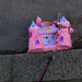 Pink Castle Pinata in the gutter