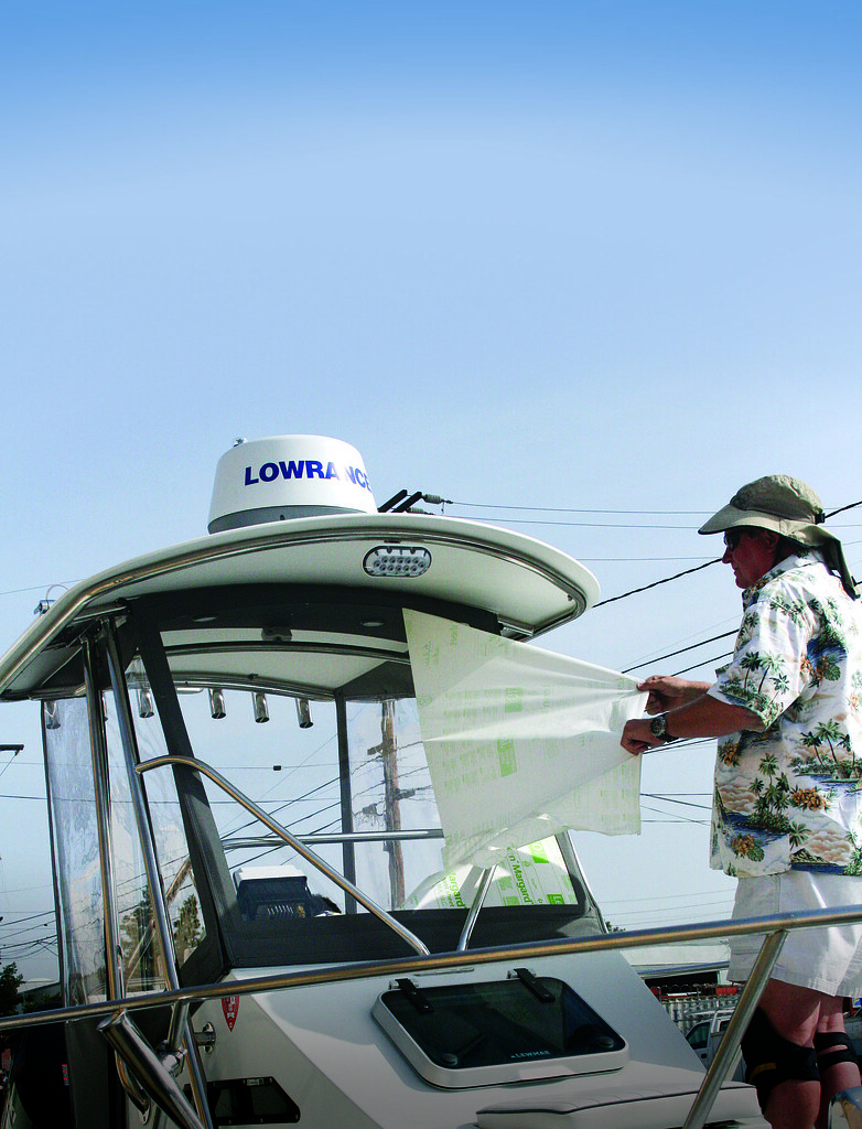 Clear Polycarbonate helm enclosures for boat: Removing protective adhesive sheets (Step Eight)