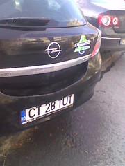automobile(1.0), automotive exterior(1.0), opel(1.0), vehicle(1.0), city car(1.0), compact car(1.0), bumper(1.0), sedan(1.0), land vehicle(1.0), vehicle registration plate(1.0),