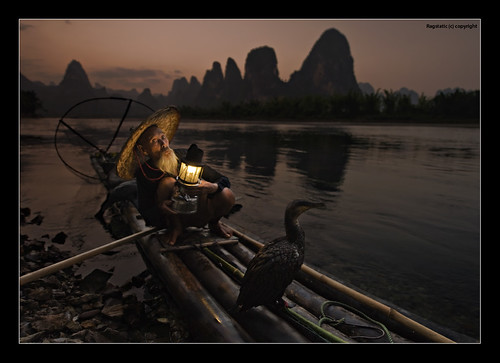 world life china travel light sunset people mountains bird heritage nature water face hat silhouette river liriver fisherman nikon exposure glow moody view dusk earth guilin rags quality culture straw scene human cormorant raft lantern ng karst publication nationalgeographic subtle guangxi lifescape xingping d700
