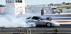 auto racing(0.0), stock car racing(0.0), motorcycle racing(0.0), automobile(1.0), racing(1.0), sport venue(1.0), vehicle(1.0), sports(1.0), performance car(1.0), race(1.0), automotive design(1.0), drifting(1.0), motorsport(1.0), drag racing(1.0), race track(1.0), supercar(1.0), sports car(1.0),