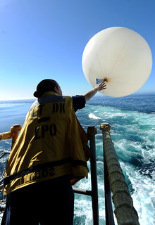 "In this file photo, Aerographer's Mate 3rd Class Chelsea Williams releases a weather balloon on the fantail aboard the aircraft carrier USS John C. Stennis (CVN 74) as the ship prepares to conduct ""work-ups"" off the coast of Southern California Jan. 17 in preparation for deployment.  (U.S. Navy photo by Mass Communication Specialist 3rd Class Kenneth Abbate)"