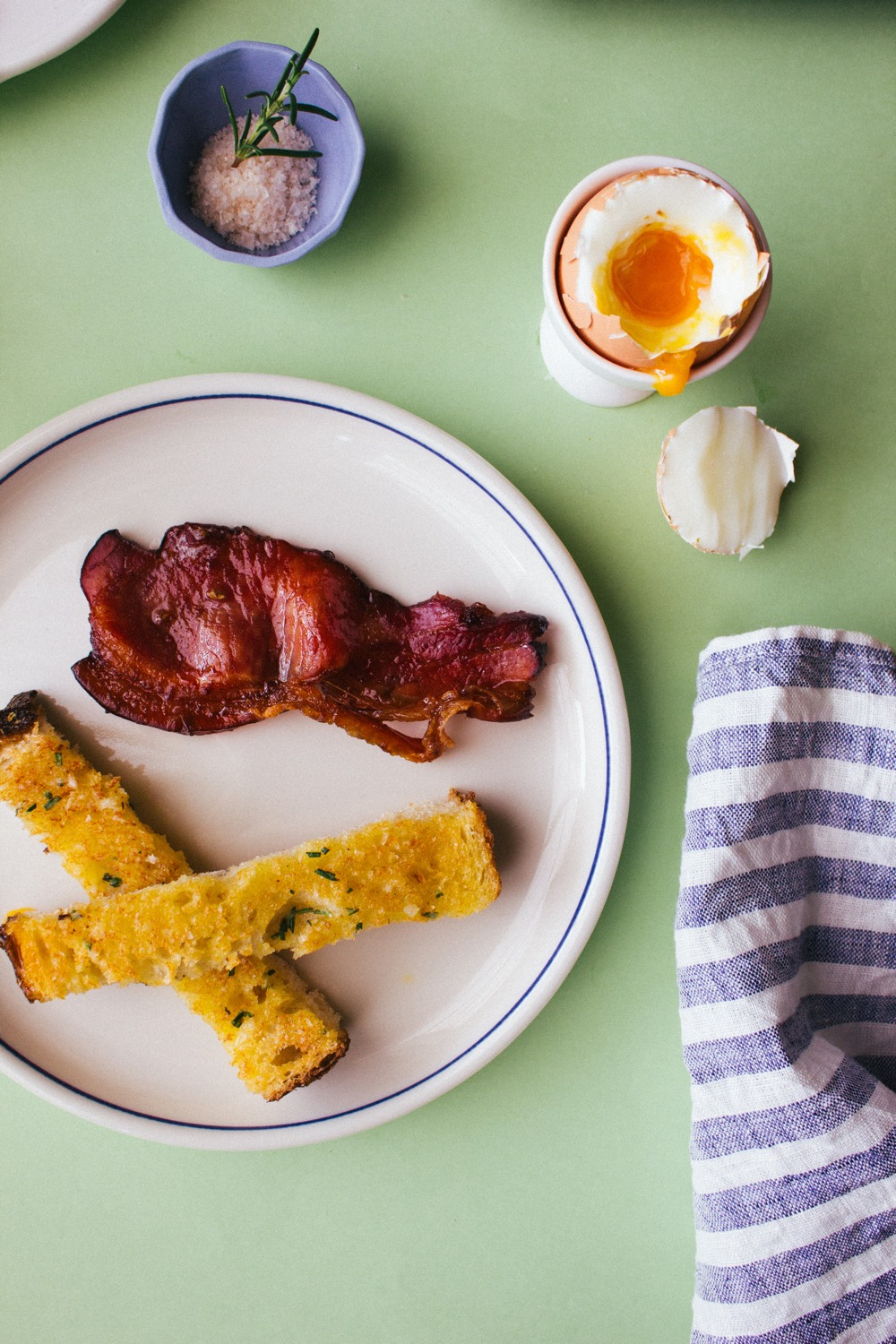 Soft-boiled eggs with herbed soldiers and espresso glazed bacon