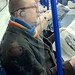 Man on the tube oblivious of his sleeping inner child. by Spacey101