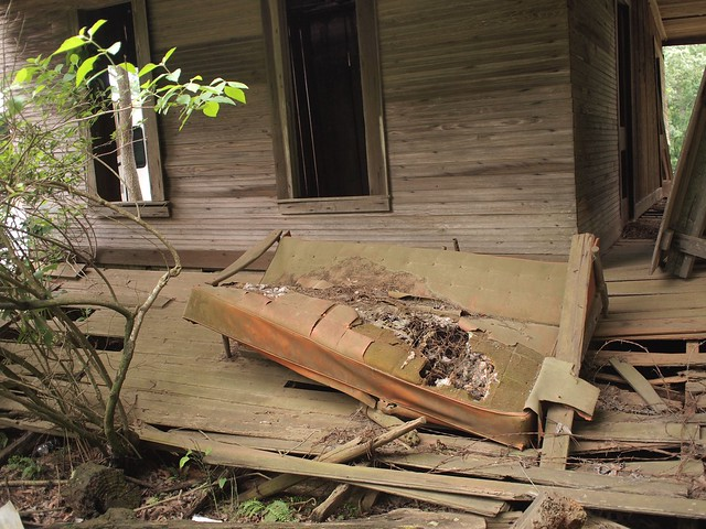 Dead sofa on dead porch