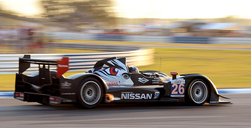 light sunset sun motion blur race fire nikon nissan florida 26 03 flame mans le american series hours fl 12 sebring endurance panning lemans p2 raceway alms backfire lmp2 oreca backflash sebringinternationalraceway d7000 signatech