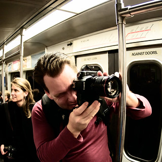 The Man on the Red Line in the Red Shirt with the Red Lens and Matching Wife in the 'Professional Series Lens' Dress