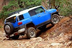 automobile(1.0), automotive exterior(1.0), sport utility vehicle(1.0), vehicle(1.0), toyota fj cruiser(1.0), compact sport utility vehicle(1.0), off-roading(1.0), off-road vehicle(1.0), bumper(1.0), land vehicle(1.0),