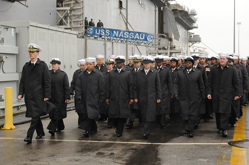 USS Nassau Sailors march in formation during ships decommissioning ceremony.
