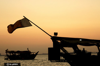 Traditional dhow boat with Qatar's flag (Doha, Qatar)
