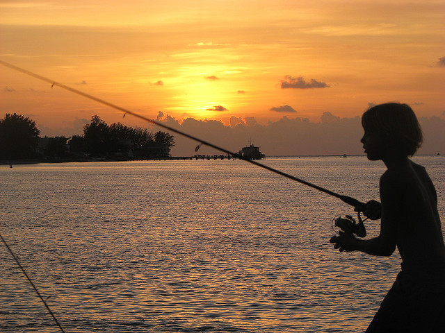 Youngster fishing off florida pier flickr photo sharing for Florida fishing license app