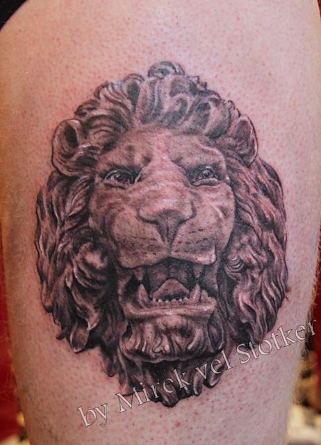lion head sculpture  tattoo by Mirek vel Stotker