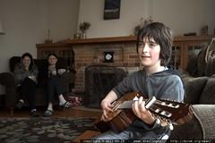 flynn playing guitar for rachel & megan
