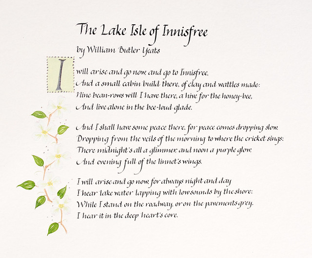 The Lake Isle of Innisfree poem in handwritten italic calligraphy with spring blossom illustration