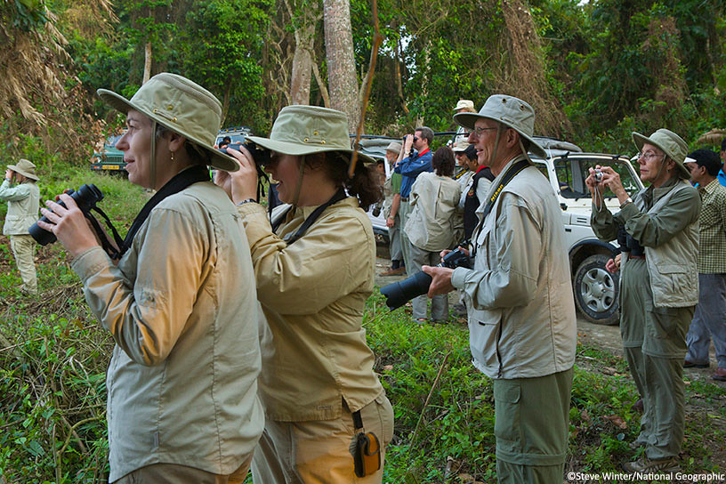 Tourists observing Kaziranga's wildlife