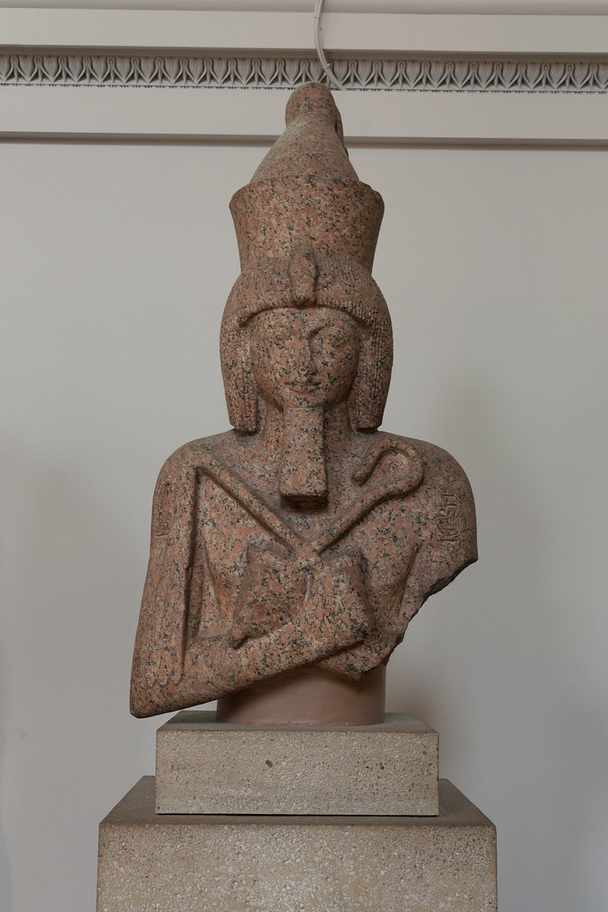 Upper part of a red granite colossal statue of Ramesses II.  From the Temple of Khnum From Aswan, Elephantine Island 19th Dynasty, around 1250 BC  The British Museum allows photo shooting providing there is no financial gain.  Please respect their policy