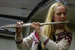 string instrument(0.0), brass instrument(0.0), flute(1.0), western concert flute(1.0), flautist(1.0), wind instrument(1.0),